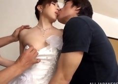 Japanese model in a wedding costume has wild enjoyment with her fiance